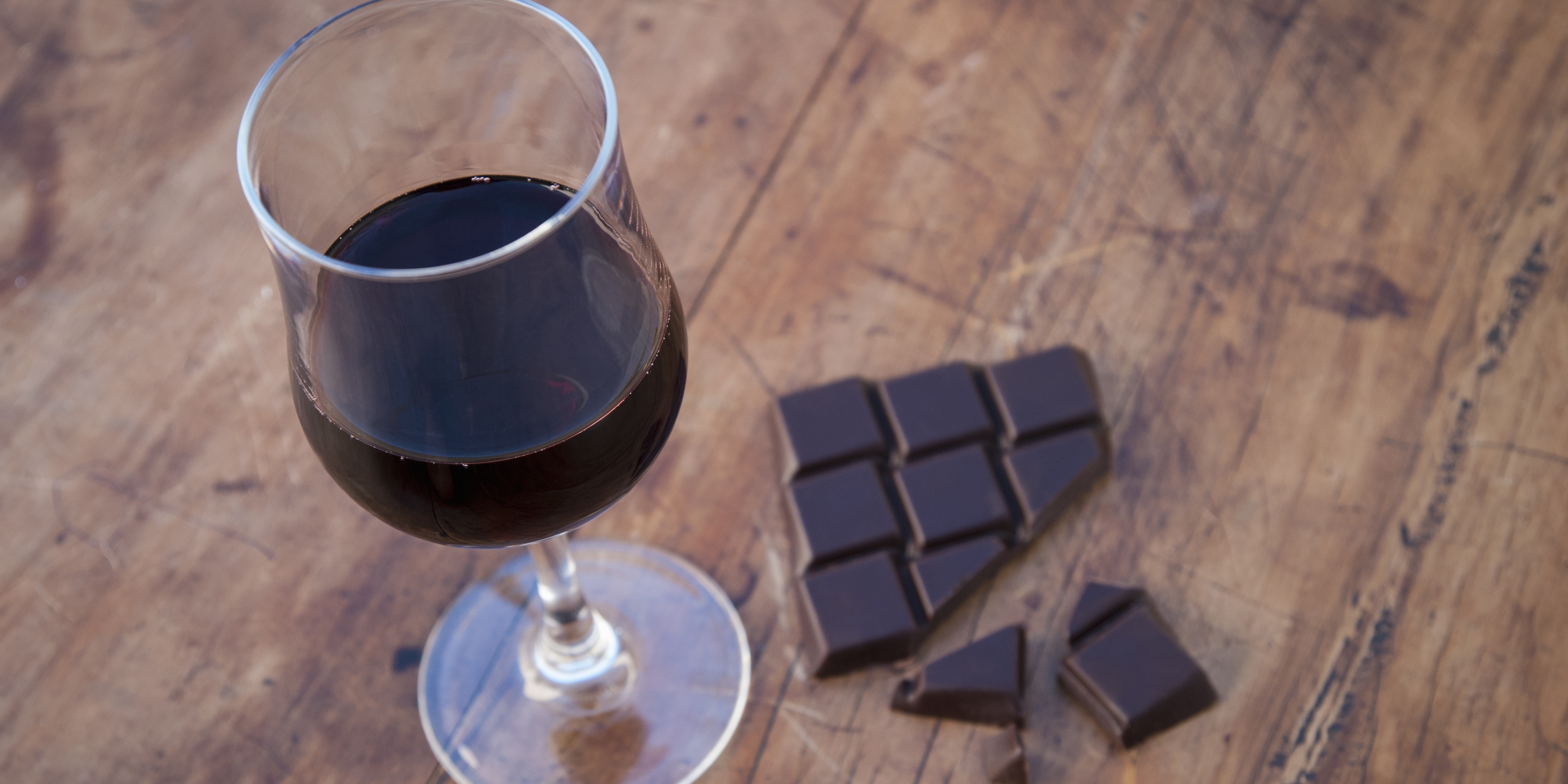 Still life with dark chocolate and red wine