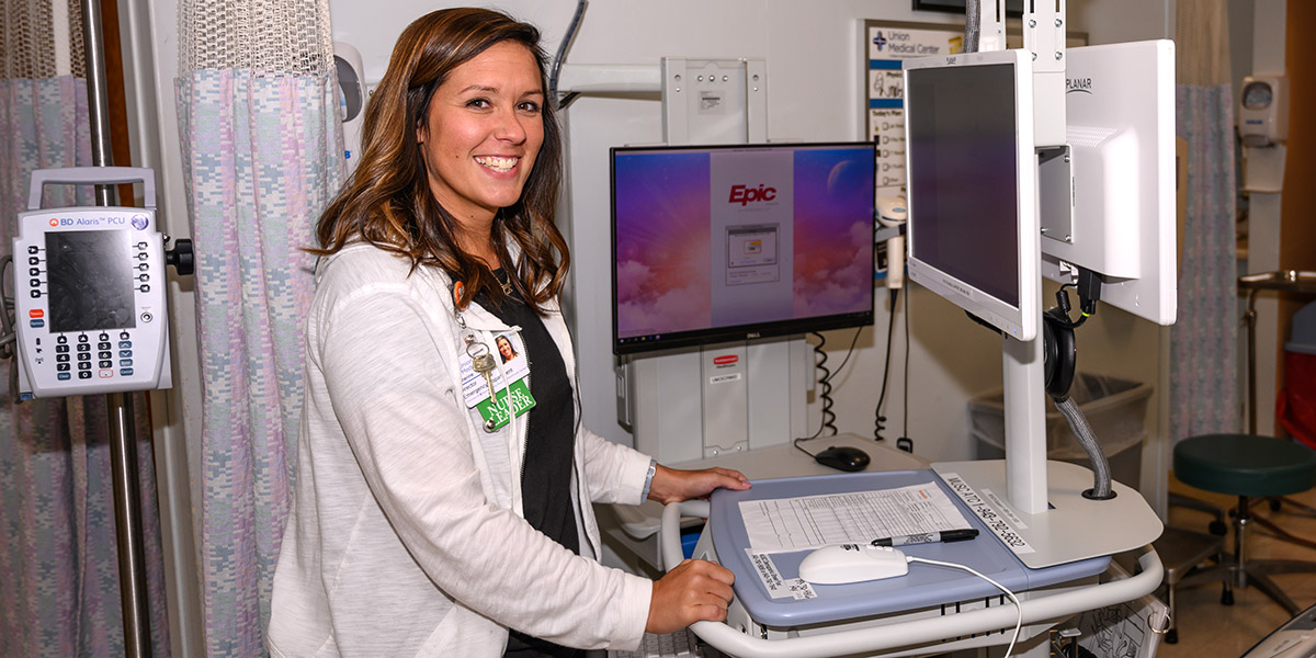Katie Henderson, RN is pictured with a computer that is used to provide new telestroke services for stroke care in minutes to the communities that Union Medical Center, Spartanburg Medical Center, Cherokee Medical Center and Pelham Medical Center serve.