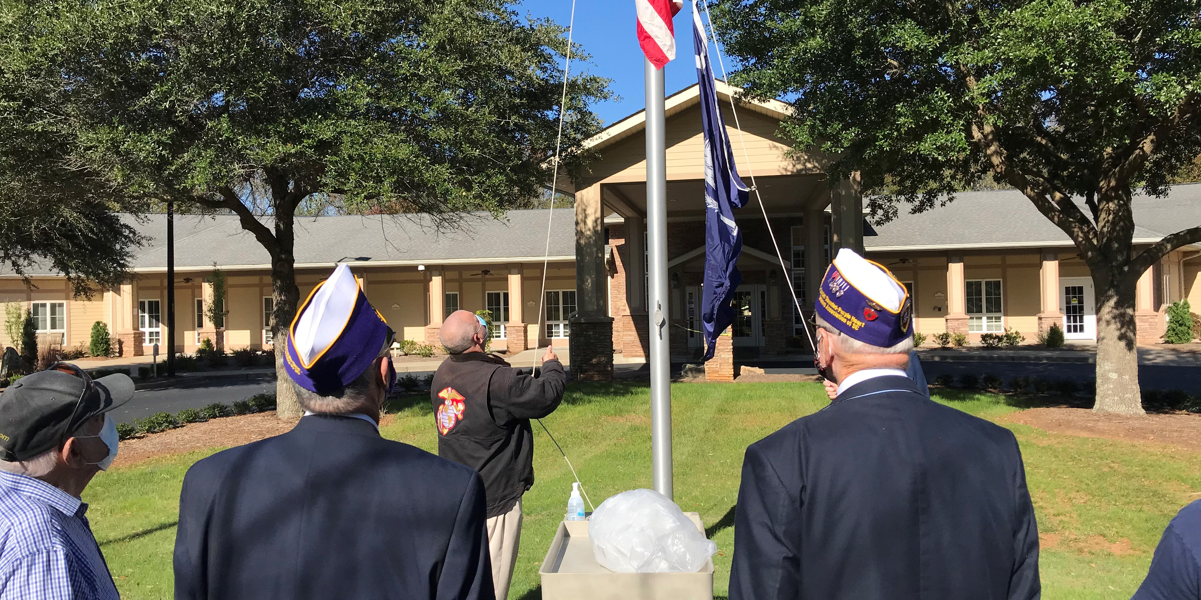 Spartanburg Regional Hospice Home raises a flag in celebration of Veteran's Day
